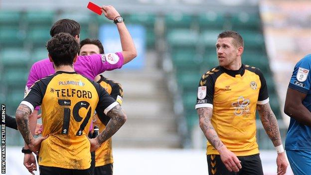 Newport midfielder Scot Bennett was sent off in the first half