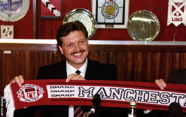 Michael Knighton poses with a Manchester United scarf
