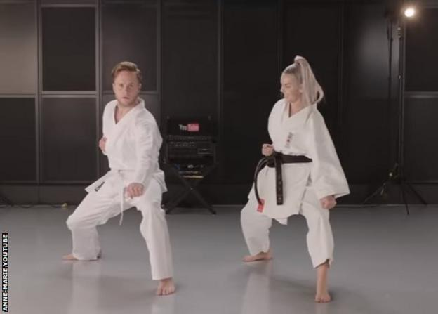 Anne Marie and Olly Murs doing karate