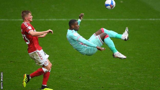 Swansea's Marc Guehi tries an overhead kick as Taylor Moore watches on