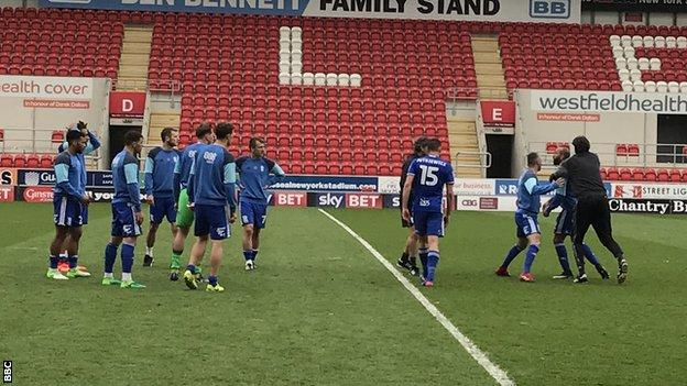 Birmingham City players argue after their draw at Rotherham United