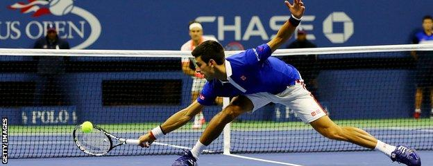 Novak Djokovic stretches for a backhand volley