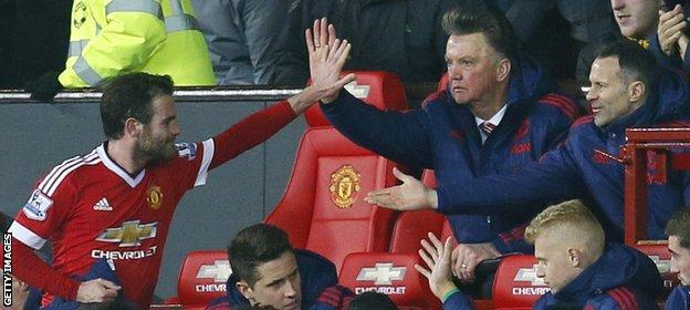 Van Gaal (centre) has a year left on his United contract