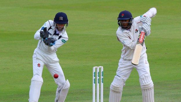 Middlesex wicketkeeper John Simpson watches Lancashire opener Haseeb Hameed carve ?? at Lord's