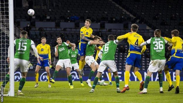 Jason Kerr rises to head home the opening goal at Hampden