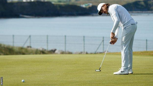 Tommy Fleetwood attempts a birdie putt on the third green at Lahinch