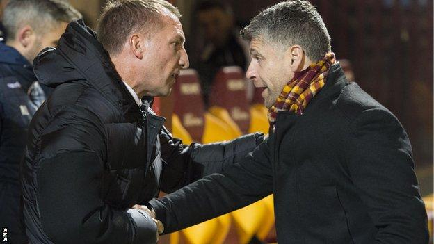 Celtic boss Brendan Rodgers shakes hands with Motherwell counterpart Stephen Robinson