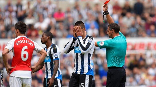 Aleksandar Mitrovic is dismissed by Andre Marriner in the defeat by Arsenal