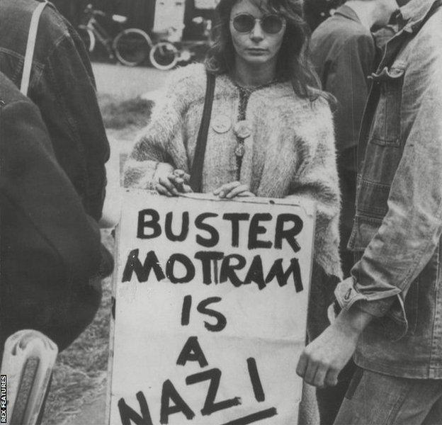 A woman holding 'Buster Mottram is a Nazi' banner during Britain's Davis Cup tie against Austria in Bristol in June 1978