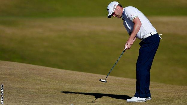Marc Warren hits a putt during round two of the US Open