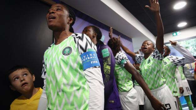 Concarneau, France, 16 August: Nigeria players sing in the tunnel before their Under-20 Women's World Cup quarter-final against Spain. (Photo by Alex Grimm - Fifa/Fifa via Getty Images)