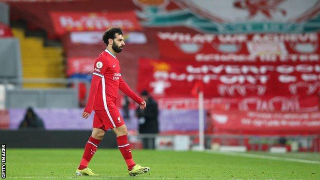 Mohamed Salah walks off the pitch against Chelsea