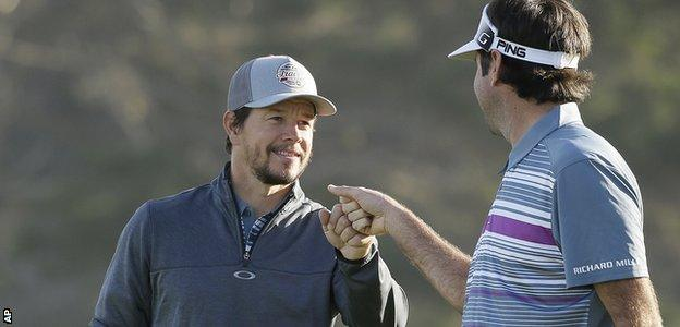 Actor Mark Wahlberg fist pumps with world number six golfer Bubba Watson