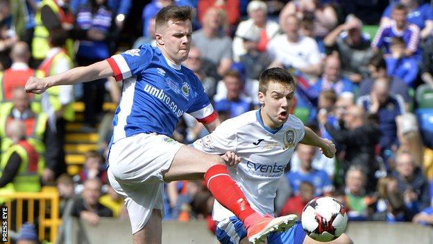 Linfield's Niall Quinn and Brad Lyons of Coleraine in action during the Irish Cup final