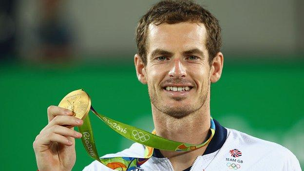 Andy Murray holds up his Rio 2016 Olympics gold medal