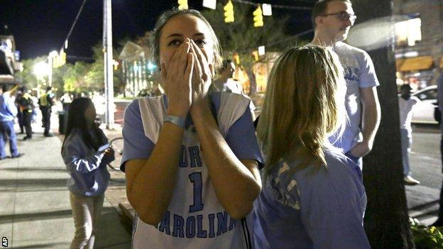 Fans in the streets of North Carolina have contrasting emotions