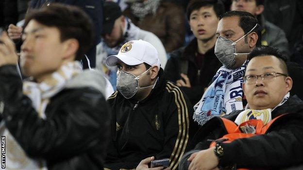 Some Real Madrid fans wore protective masks when their side first met Manchester City in the Champions League