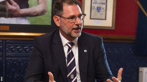 John Nelms is managing director of Dundee, whose vote could decide the SPFL's resolution