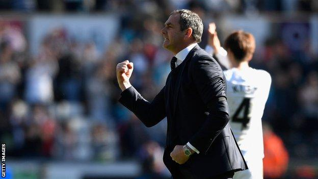 Swansea City manager Paul Clement celebrates the victory over Stoke City