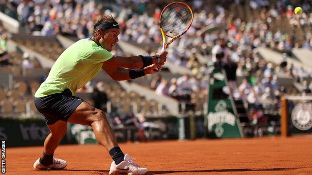 Rafael Nadal returns in a game against Diego Schwartzman at the French Open