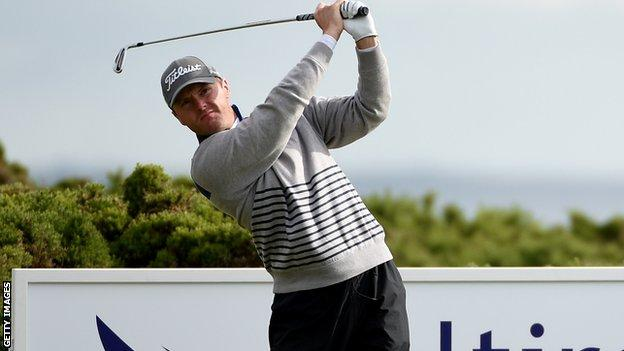 Michael Hoey plays his tee shot at the third hole at Murcar Links on Thursday
