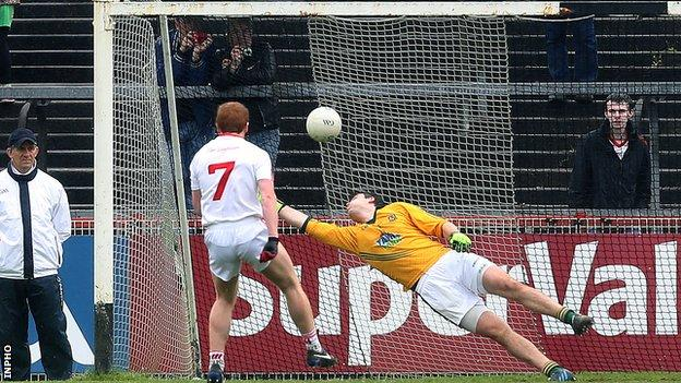 Peter Harte watches his penalty hit the Meath net
