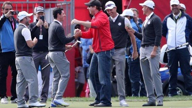 Rory McIlroy congratulates American fan for holing putt
