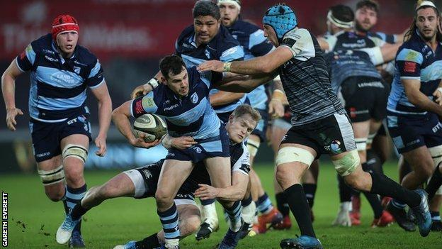 Cardiff Blues' Tomos Williams takes on the Ospreys defence