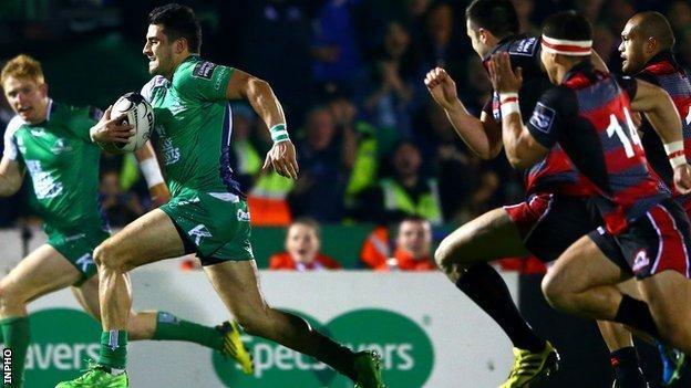 Connacht's Tiernan O'Halloran sprints clear to score a try against Edinburgh