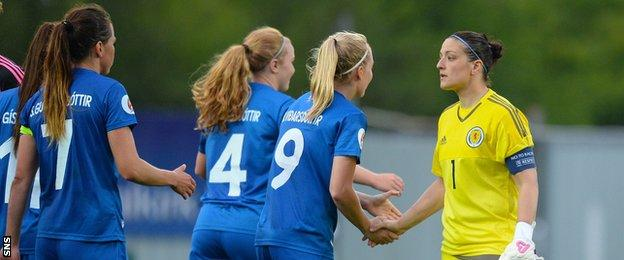 Iceland players shake hands with Scotland's Gemma Fay