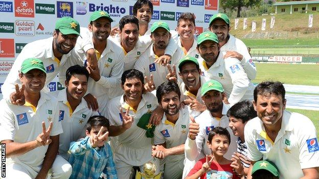 Pakistan celebrate with the Test series trophy