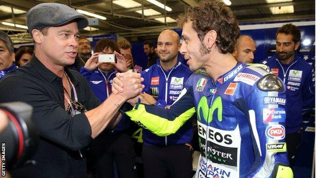 Brad Pitt meeting Valentino Rossi at a racetrack