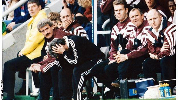 Kevin Keegan with his head in his hands while managing Newcastle in 1996