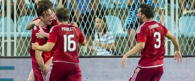 Andrew Considine (left) celebrates opening the scoring for Aberdeen against Rijeka