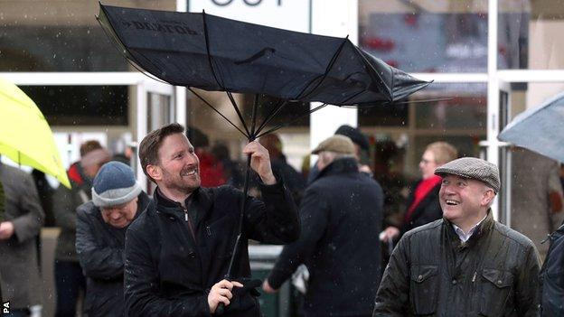 Man loses his umbrella in the wind