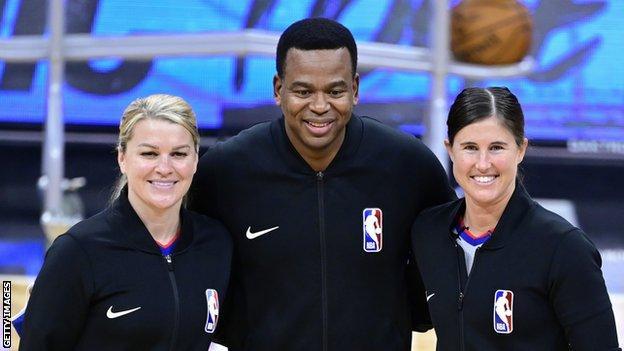 Referees Natalie Sago, Sean Wright and Jenna Schroeder