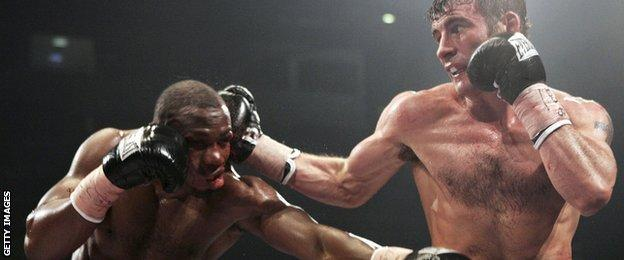 Joe Calzaghe catches Jeff Lacy with a right