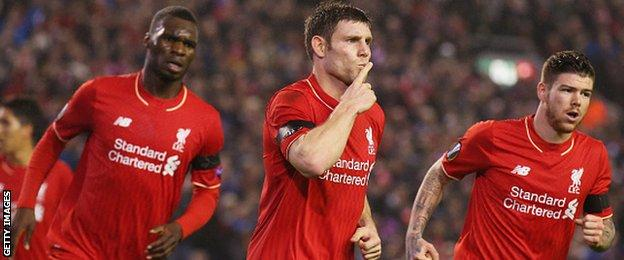 James Milner (centre) celebrates equalising from the penalty spot for Liverpool against Bordeaux