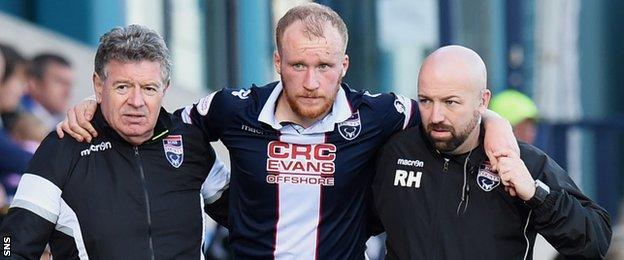 Ross County's Liam Boyce is carried off injured