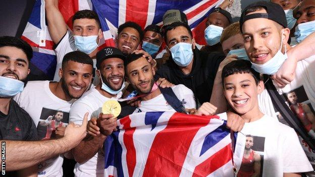 Boxer Galal Yafai celebrates with brother at Heathrow Airport