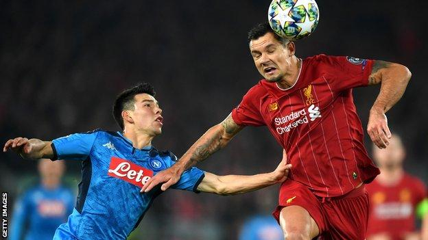 Dejan Lovren makes a header against Napoli