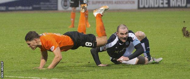 James McPake upends John Rankin during the Dundee derby