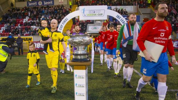 Cliftonville and Ards come onto the pitch prior to the kick-off at Solitude