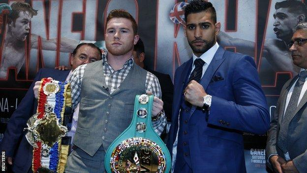 "Saul ""Canelo"" Alvarez and Amir Khan pose during the press conference"