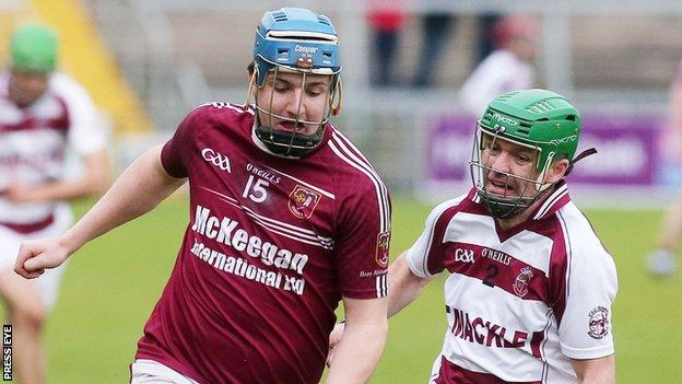Michael Kearney and Christy McNaughton in action at the Athletic Grounds