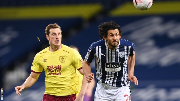 Ahmed Hegazi heads the ball ahead of Burnley's Chris Wood