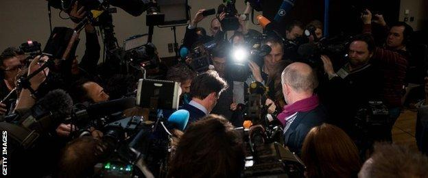 Lord Coe is surrounded by reporters in Munich
