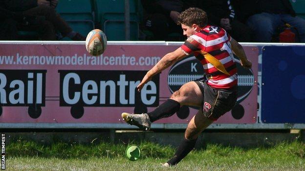 Laurence May kicks a penalty