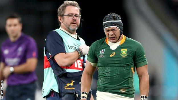 Cheslin Kolbe of South Africa receives treatment during the Rugby World Cup 2019 Quarter Final match between Japan and South Africa at the Tokyo Stadium on October 20, 2019 in Chofu, Tokyo, Japan. (Photo by Cameron Spencer/Getty Images)