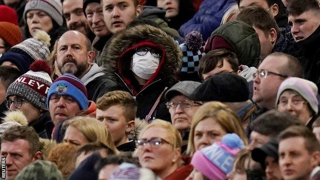 Shot of the crowd during Burnley's game against Tottenham with one fan wearing a face mask